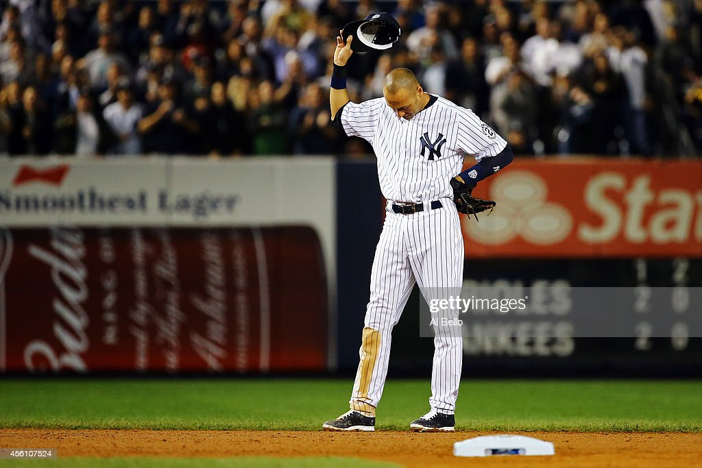 <a gi-track='captionPersonalityLinkClicked' href=/galleries/search?phrase=Derek+Jeter&family=editorial&specificpeople=167125 ng-click='$event.stopPropagation()'>Derek Jeter</a> #2 of the New York Yankees gestures from the field against the Baltimore Orioles in his last game ever at Yankee Stadium on September 25, 2014 in the Bronx borough of New York City.