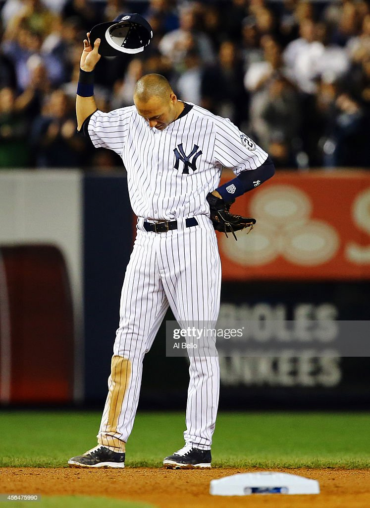 Derek Jeter #2 of the New York Yankees gestures from the field against the Baltimore Orioles in his last game ever at Yankee Stadium on September 25, 2014 in the Bronx borough of New York City.