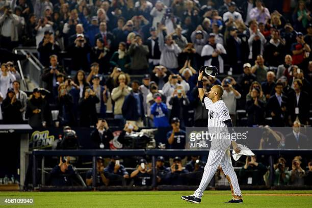 Derek Jeter of the New York Yankees gestures to the fans after a game winning RBI hit in the ninth inning against the Baltimore Orioles in his last...