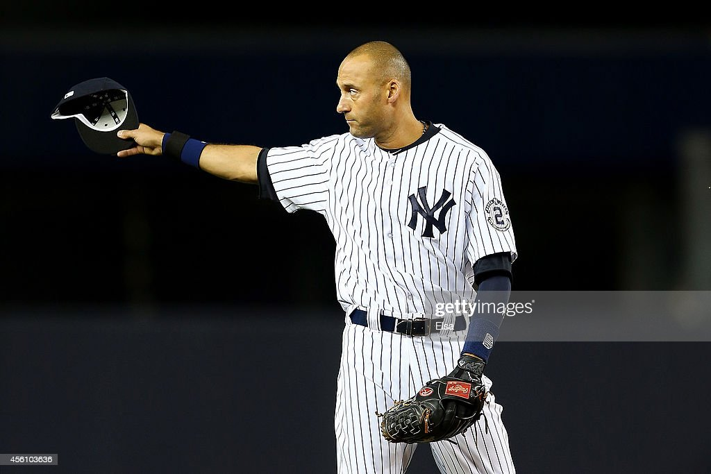 Derek Jeter #2 of the New York Yankees gestures to the fans against the Baltimore Orioles during a game at Yankee Stadium on September 25, 2014 in the Bronx borough of New York City.