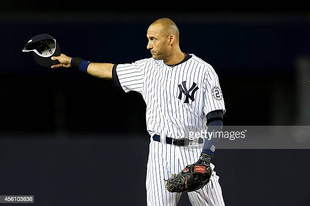 Derek Jeter of the New York Yankees gestures to the fans against the Baltimore Orioles during a game at Yankee Stadium on September 25 2014 in the...