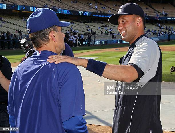 Derek Jeter of the New York Yankees greets manager Joe Torre of the Los Angeles Dodgers before their game on June 25 2010 at Dodger Stadium in Los...
