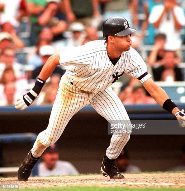 Derek Jeter of the New York Yankees hits a game winning single in the tenth inning against the Boston Red Sox 21 September at Yankee Stadium There...