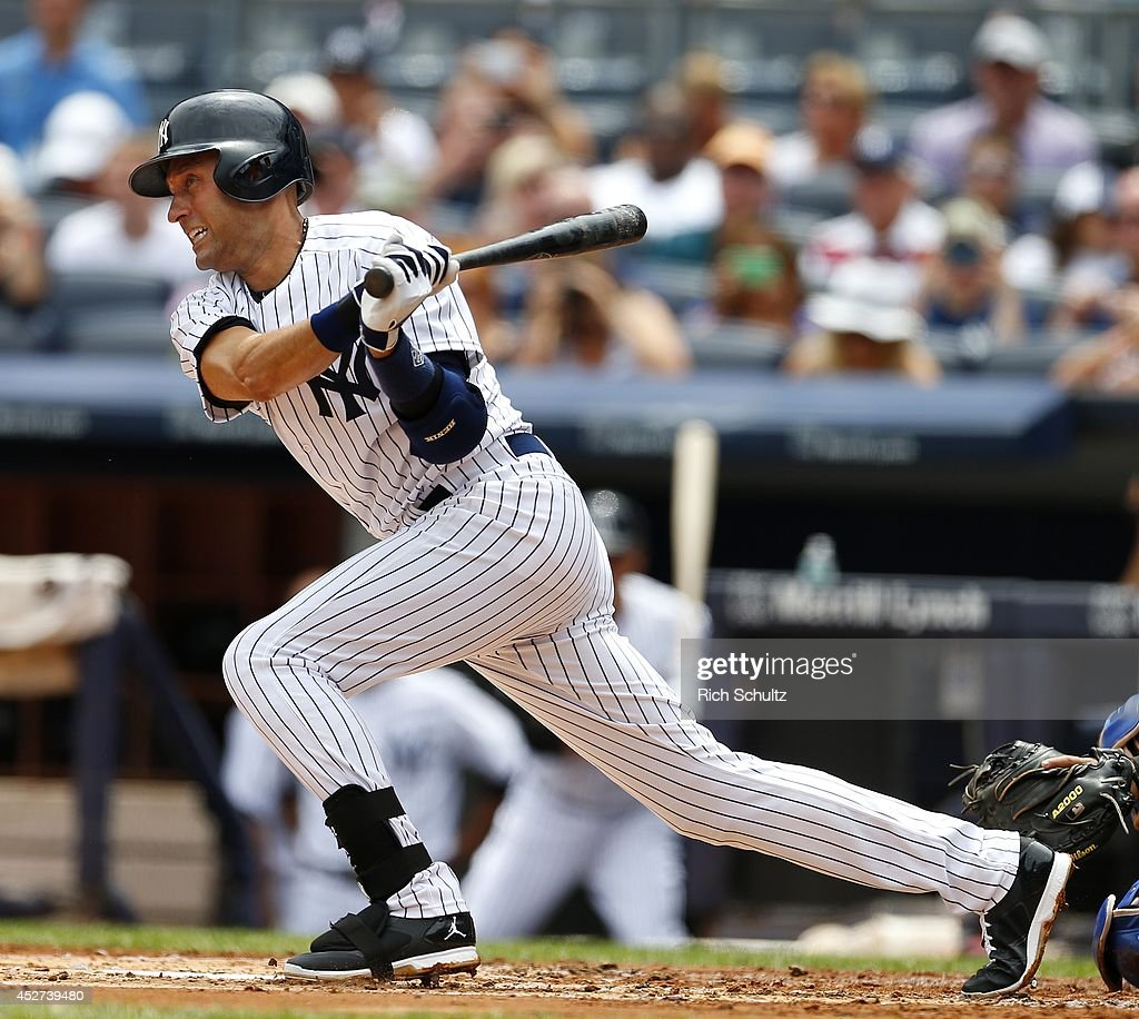 <a gi-track='captionPersonalityLinkClicked' href=/galleries/search?phrase=Derek+Jeter&family=editorial&specificpeople=167125 ng-click='$event.stopPropagation()'>Derek Jeter</a> #2 of the New York Yankees hits a single against the Toronto Blue Jays during the first inning during a MLB baseball game at Yankee Stadium on July 26, 2014 in the Bronx borough of New York City.