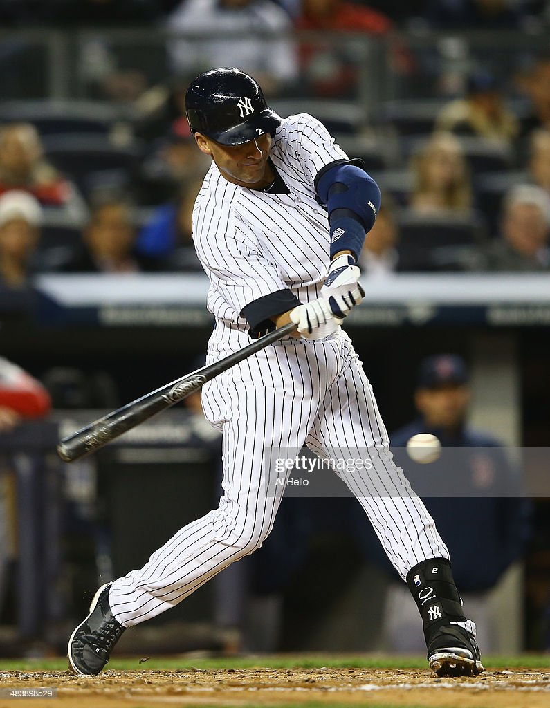 Derek Jeter #2 of the New York Yankees hits a single in the first inning against the Boston Red Sox during their game at Yankee Stadium on April 10, 2014 in the Bronx borough of New York City.