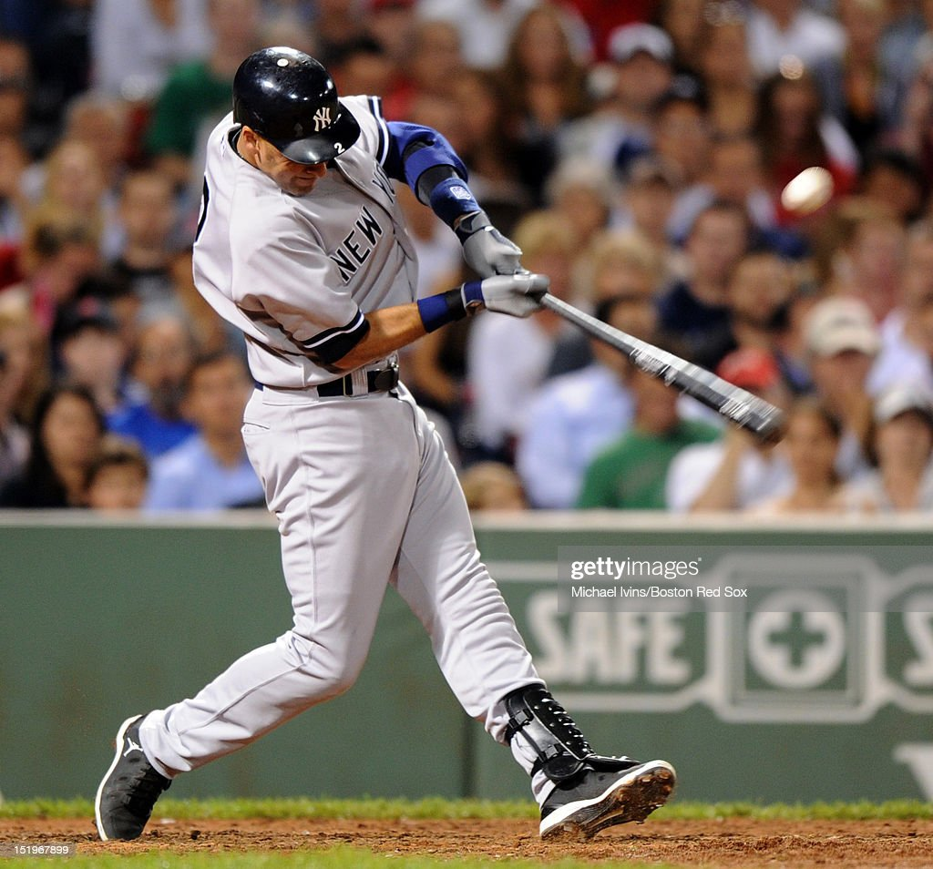 <a gi-track='captionPersonalityLinkClicked' href=/galleries/search?phrase=Derek+Jeter&family=editorial&specificpeople=167125 ng-click='$event.stopPropagation()'>Derek Jeter</a> #2 of the New York Yankees hits an RBI single against the Boston Red Sox in the seventh inning on September 13, 2012 at Fenway Park in Boston, Massachusetts.
