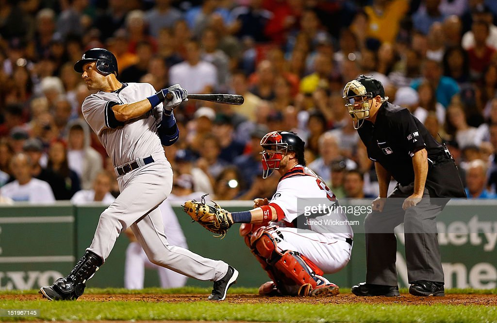 <a gi-track='captionPersonalityLinkClicked' href=/galleries/search?phrase=Derek+Jeter&family=editorial&specificpeople=167125 ng-click='$event.stopPropagation()'>Derek Jeter</a> #2 of the New York Yankees hits an RBI single in the 7th inning against the Boston Red Sox during the game on September 13, 2012 at Fenway Park in Boston, Massachusetts.