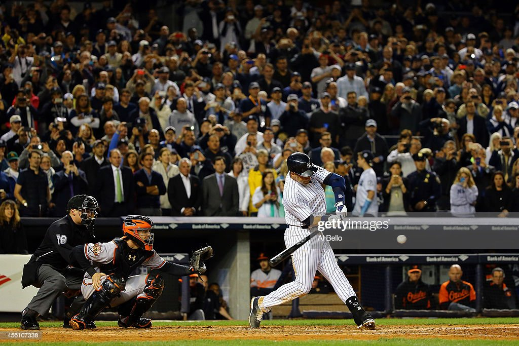 Derek Jeter #2 of the New York Yankees hits an RBI single in the seventh inning against the Baltimore Orioles in his last game ever at Yankee Stadium on September 25, 2014 in the Bronx borough of New York City.