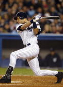 Derek Jeter of the New York Yankees hits an RBI single to score Karim Garcia in the third inning against the Florida Marlins during game 1 of the...