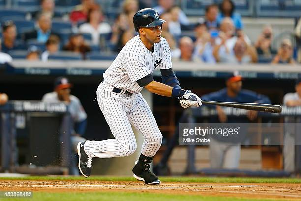 Derek Jeter of the New York Yankees in action against Houston Astros at Yankee Stadium on August 19 2014 in the Bronx borough of New York City Astros...