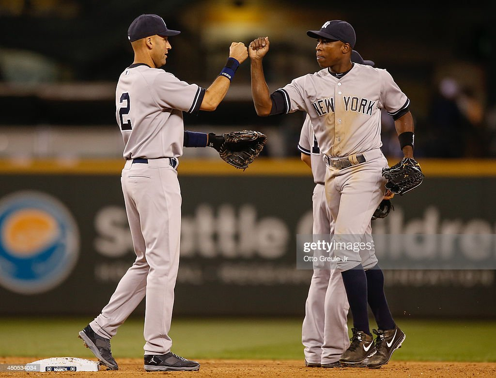 Derek Jeter #2 (L) of the New York Yankees is congratulated by Alfonso Soriano #12 after defeating the Seattle Mariners 6-3 at Safeco Field on June 12, 2014 in Seattle, Washington.