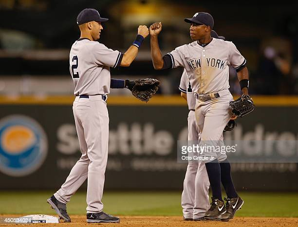 Derek Jeter of the New York Yankees is congratulated by Alfonso Soriano after defeating the Seattle Mariners 63 at Safeco Field on June 12 2014 in...