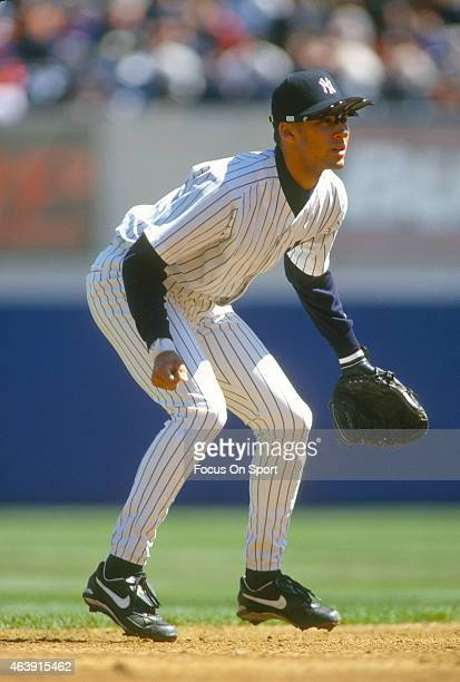 Derek Jeter of the New York Yankees is down and ready to make a play on the ball during an Major League Baseball game circa 1996 at Yankee Stadium in...