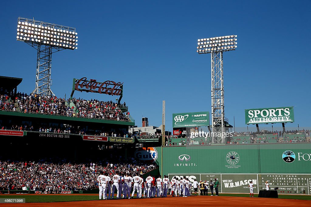 Derek Jeter of the New York Yankees is honored prior to the last game of the season and his career against the Boston Red Sox at Fenway Park on...