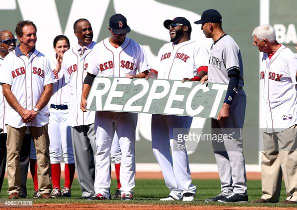 Derek Jeter of the New York Yankees is presented with a piece of the Green Monster signed by the Boston Red Sox prior to the last game of the season...