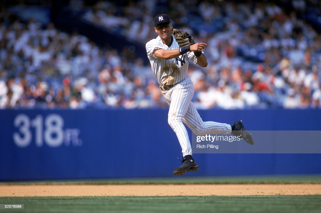 Derek Jeter of the New York Yankees jumps and throws at Yankee Stadium on July 17 1999 in the Bronx New York