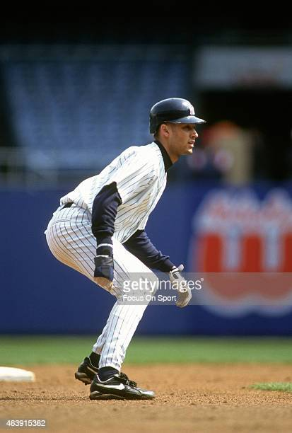 Derek Jeter of the New York Yankees leads off of second base during an Major League Baseball game circa 1996 at Yankee Stadium in the Bronx borough...