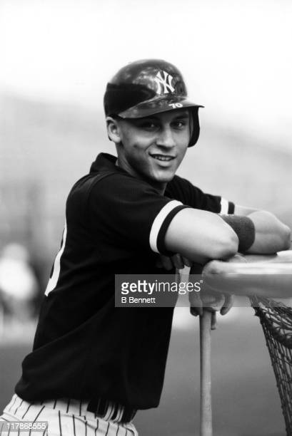 Derek Jeter of the New York Yankees leans on the batting cage during batting practice before a spring training game circa 1994