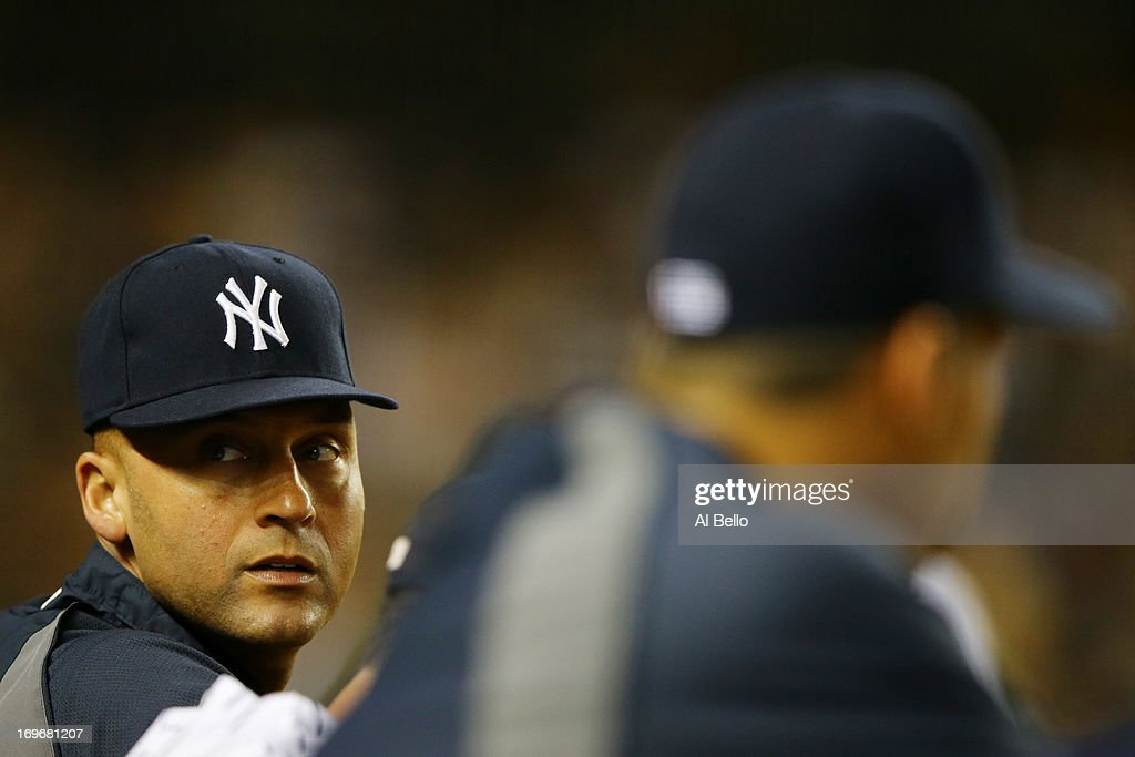 <a gi-track='captionPersonalityLinkClicked' href=/galleries/search?phrase=Derek+Jeter&family=editorial&specificpeople=167125 ng-click='$event.stopPropagation()'>Derek Jeter</a> #2 of the New York Yankees looks in during their game against the New York Mets on May 30, 2013 at Yankee Stadium in the Bronx borough of New York City
