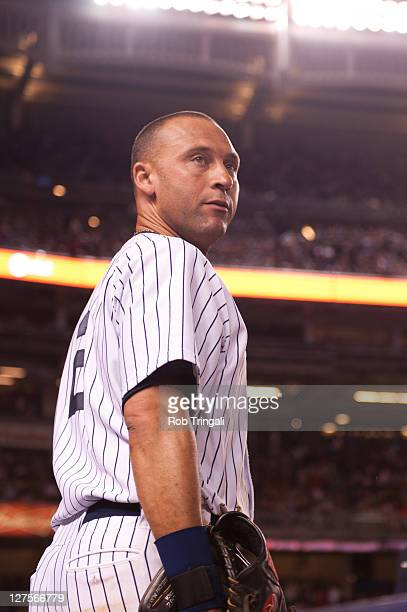 Derek Jeter of the New York Yankees looks on during the game against the Oakland Athletics at Yankee Stadium on August 24 2011 in the Bronx borough...