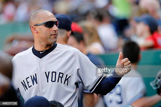 Derek Jeter of the New York Yankees looks on from the dugout against the Boston Red Sox during a game at Fenway Park on September 27 2014 in Boston...