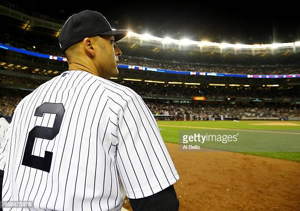 Derek Jeter of the New York Yankees looks on from the dugout against the Baltimore Orioles in his last game ever at Yankee Stadium on September 25...