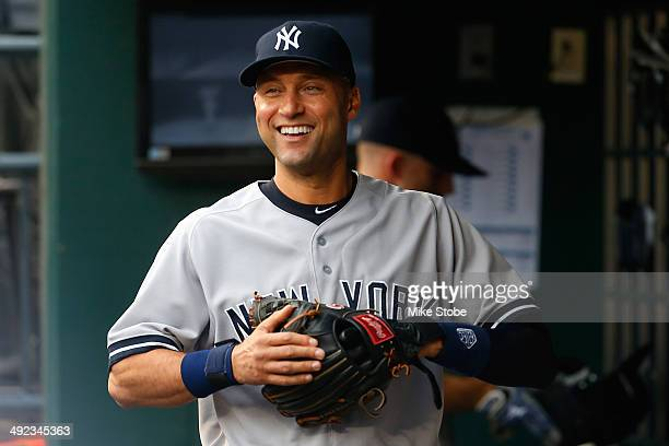 Derek Jeter of the New York Yankees looks on from the dugout prior to the game against the New York Mets on May 15 2014 at Citi Field in the Flushing...