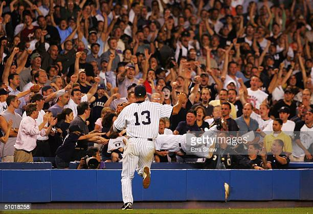 Derek Jeter of the New York Yankees makes a diving catch in the 12th inning of their game against the Boston Red Sox on July 1 2004 at Yankee Stadium...