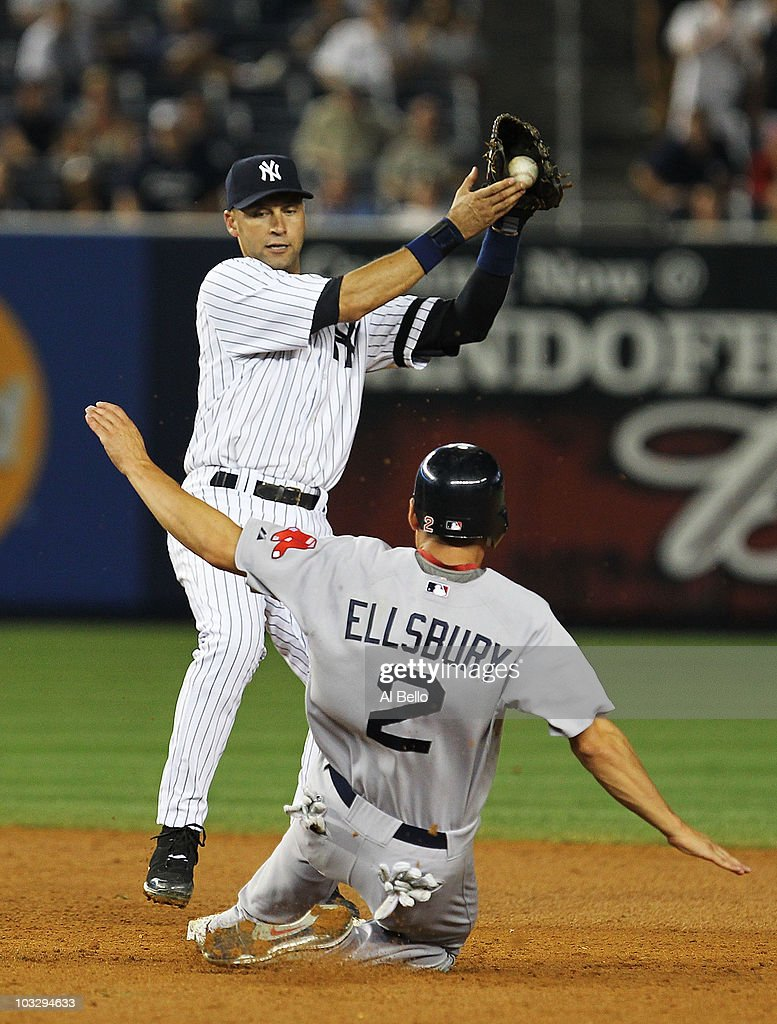 <a gi-track='captionPersonalityLinkClicked' href=/galleries/search?phrase=Derek+Jeter&family=editorial&specificpeople=167125 ng-click='$event.stopPropagation()'>Derek Jeter</a> #2 of the New York Yankees makes the final out of the game securing a 7-2 win as <a gi-track='captionPersonalityLinkClicked' href=/galleries/search?phrase=Jacoby+Ellsbury&family=editorial&specificpeople=4172583 ng-click='$event.stopPropagation()'>Jacoby Ellsbury</a> #2 of the Boston Red Sox slides during their game on August 8, 2010 at Yankee Stadium in the Bronx borough of New York City.