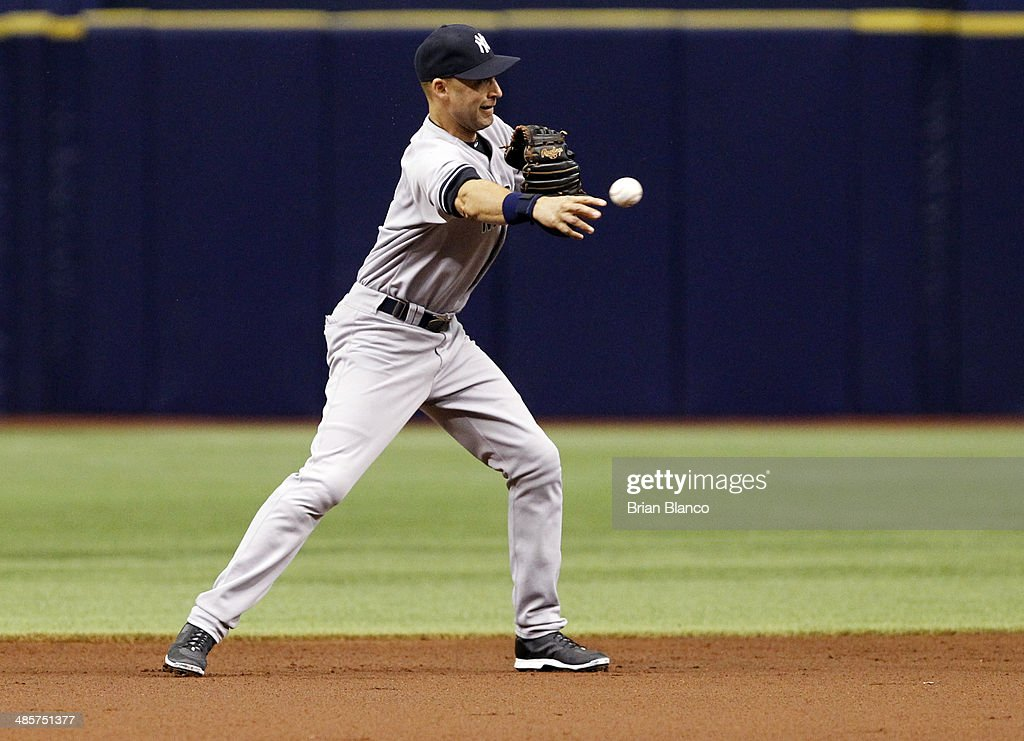 Derek Jeter #2 of the New York Yankees makes the throw to first base to turn the double play with the out on Logan Forsythe of the Tampa Bay Rays to end the top of the first inning of a game on April 20, 2014 at Tropicana Field in St. Petersburg, Florida.