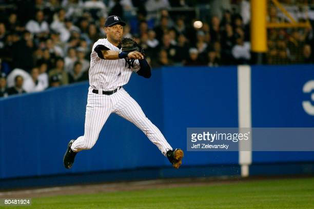 Derek Jeter of the New York Yankees makes the throw to second for the out to end the third inning after fielding the hit by Alex Rios of the Toronto...