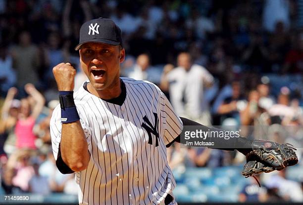 Derek Jeter of the New York Yankees pumps his fist after completing a double play to end an eighth inning rally against the Chicago White Sox on on...