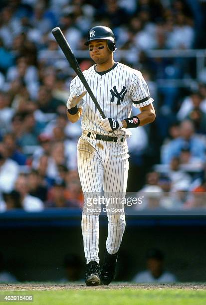 Derek Jeter of the New York Yankees reacts after a pitch during an Major League Baseball game circa 1996 at Yankee Stadium in the Bronx borough of...