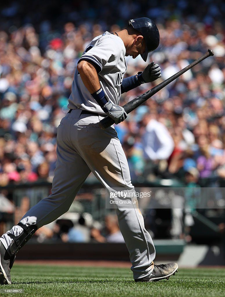 Derek Jeter #2 of the New York Yankees reacts after being hit with a pitch against the Seattle Mariners at Safeco Field on July 25, 2012 in Seattle, Washington. The Yankees defeated the Mariners 5-2.