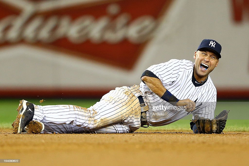 <a gi-track='captionPersonalityLinkClicked' href=/galleries/search?phrase=Derek+Jeter&family=editorial&specificpeople=167125 ng-click='$event.stopPropagation()'>Derek Jeter</a> #2 of the New York Yankees reacts after he injured his leg in the top of the 12th inning against the Detroit Tigers during Game One of the American League Championship Series at Yankee Stadium on October 13, 2012 in the Bronx borough of New York City, New York.