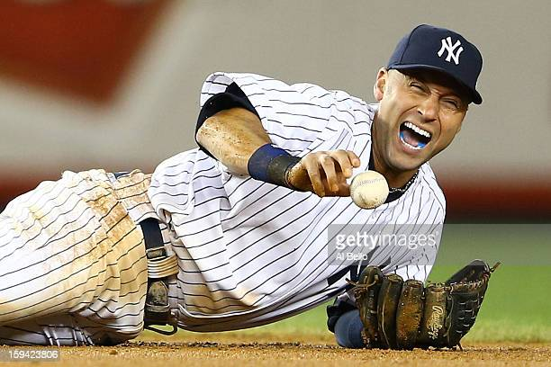 Derek Jeter of the New York Yankees reacts after he injured his leg in the top of the 12th inning against the Detroit Tigers during Game One of the...