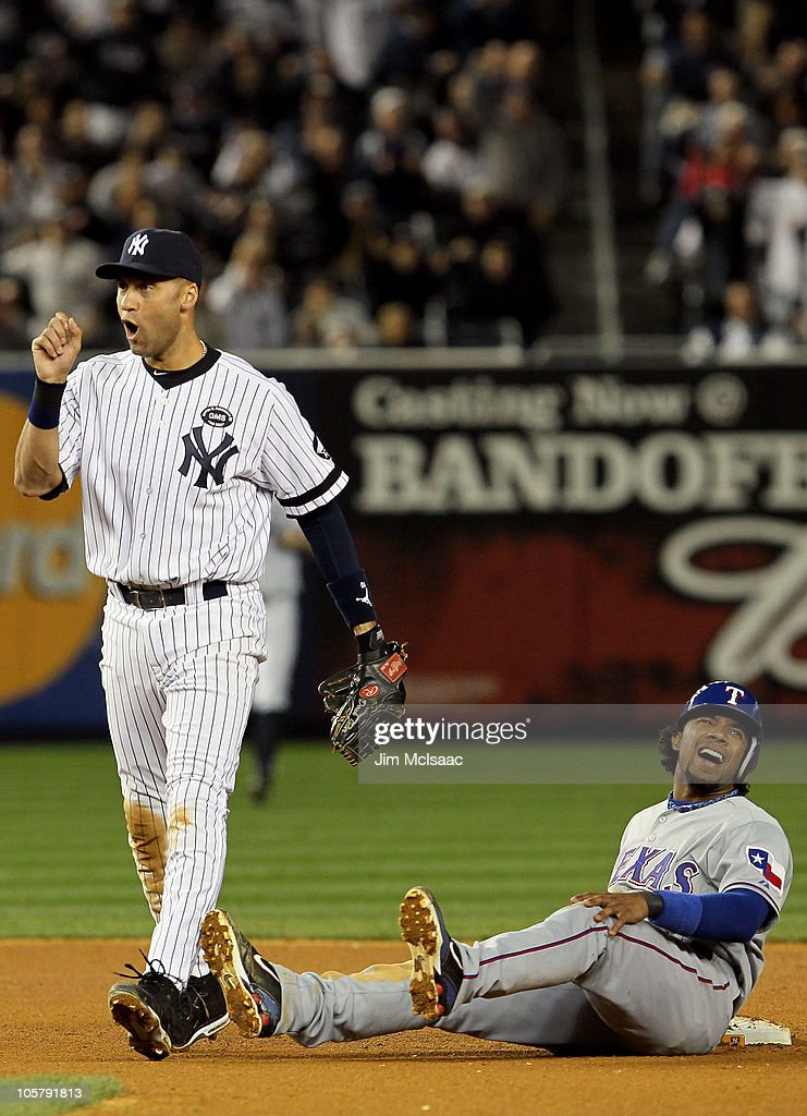<a gi-track='captionPersonalityLinkClicked' href=/galleries/search?phrase=Derek+Jeter&family=editorial&specificpeople=167125 ng-click='$event.stopPropagation()'>Derek Jeter</a> #2 of the New York Yankees reacts after he tagged out <a gi-track='captionPersonalityLinkClicked' href=/galleries/search?phrase=Elvis+Andrus&family=editorial&specificpeople=4845974 ng-click='$event.stopPropagation()'>Elvis Andrus</a> #1 of the Texas Rangers on a pickoff play at second base in the top of the seventh inninng of Game Five of the ALCS during the 2010 MLB Playoffs at Yankee Stadium on October 20, 2010 in the Bronx borough of New York City.