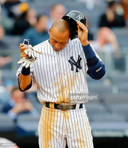 Derek Jeter of the New York Yankees reacts after striking out to end the sixth inning against the Baltimore Orioles at Yankee Stadium on April 8 2014...
