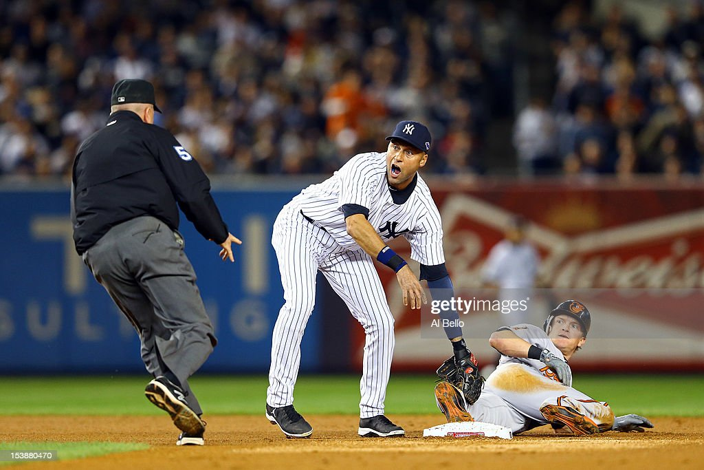 <a gi-track='captionPersonalityLinkClicked' href=/galleries/search?phrase=Derek+Jeter&family=editorial&specificpeople=167125 ng-click='$event.stopPropagation()'>Derek Jeter</a> #2 of the New York Yankees reacts after tagging out <a gi-track='captionPersonalityLinkClicked' href=/galleries/search?phrase=Nate+McLouth&family=editorial&specificpeople=536572 ng-click='$event.stopPropagation()'>Nate McLouth</a> #9 of the Baltimore Orioles in the first inning of Game Three of the American League Division Series at Yankee Stadium on October 10, 2012 in the Bronx borough of New York City.