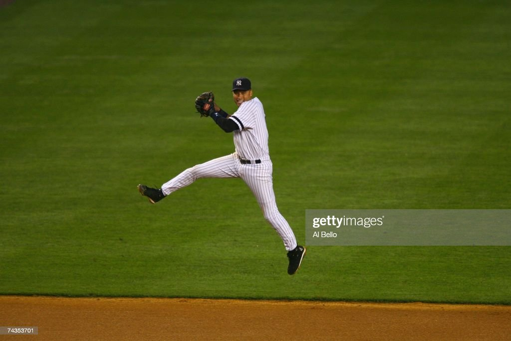 <a gi-track='captionPersonalityLinkClicked' href=/galleries/search?phrase=Derek+Jeter&family=editorial&specificpeople=167125 ng-click='$event.stopPropagation()'>Derek Jeter</a> #2 of the New York Yankees readies to throw against the Boston Red Sox on May 23, 2007 at Yankee Stadium in The Bronx, New York. The Yankees won 8-3.