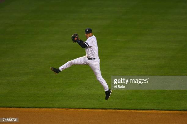 Derek Jeter of the New York Yankees readies to throw against the Boston Red Sox on May 23 2007 at Yankee Stadium in The Bronx New York The Yankees...
