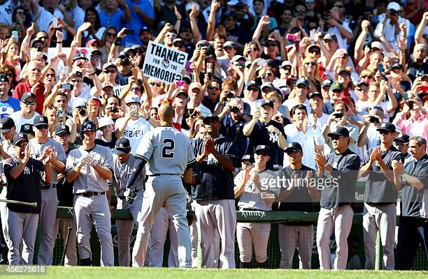 Derek Jeter of the New York Yankees returns to the dugout after hitting a single for his last career at bat in the third inning against the Boston...