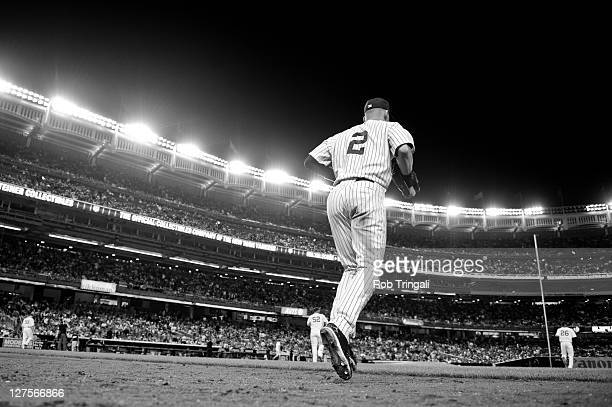 Derek Jeter of the New York Yankees returns to the field for another inning during the game against the Oakland Athletics at Yankee Stadium on August...