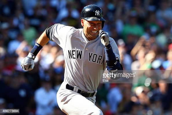 Derek Jeter of the New York Yankees runs to first after hitting a single for his last career at bat in the third inning against the Boston Red Sox...