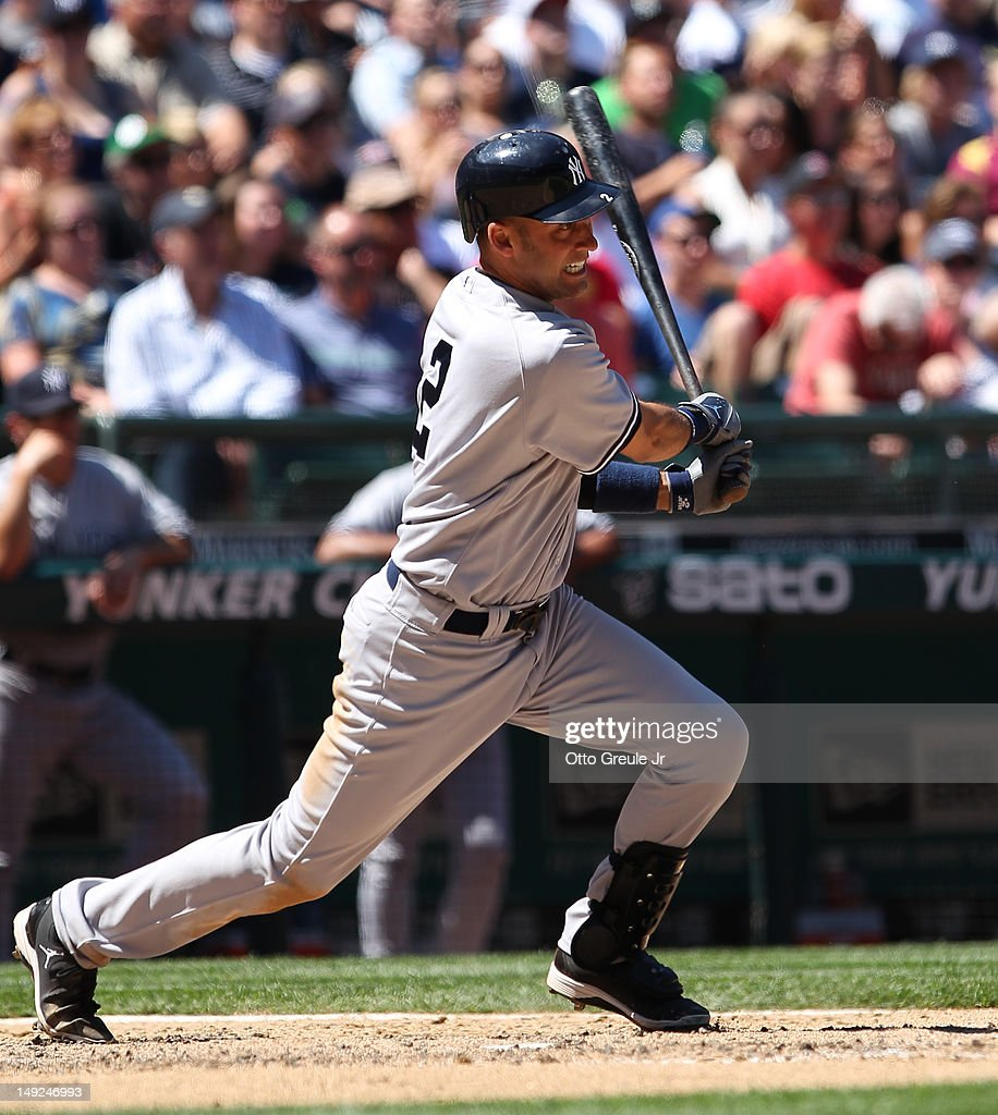 Derek Jeter #2 of the New York Yankees singles against the Seattle Mariners at Safeco Field on July 25, 2012 in Seattle, Washington. The Yankees defeated the Mariners 5-2.