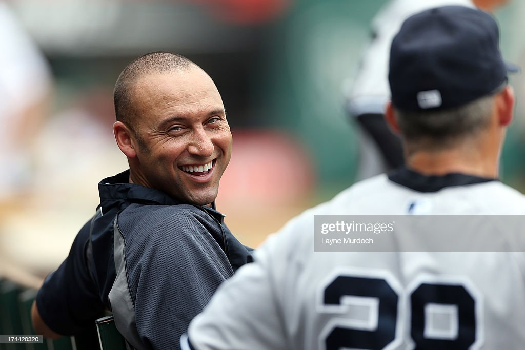 <a gi-track='captionPersonalityLinkClicked' href=/galleries/search?phrase=Derek+Jeter&family=editorial&specificpeople=167125 ng-click='$event.stopPropagation()'>Derek Jeter</a> of the New York Yankees sits in the dugout and jokes with manager <a gi-track='captionPersonalityLinkClicked' href=/galleries/search?phrase=Joe+Girardi&family=editorial&specificpeople=208659 ng-click='$event.stopPropagation()'>Joe Girardi</a> #28 during a game against the Texas Rangers on July 25, 2013 at the Rangers Ballpark in Arlington in Arlington, Texas.