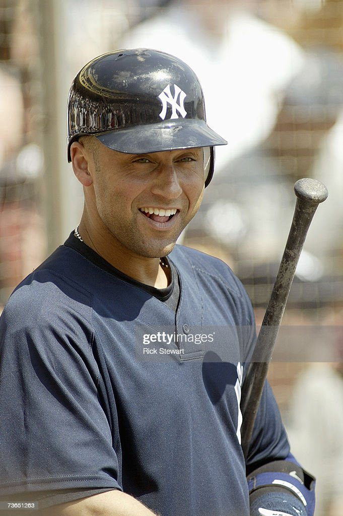 Derek Jeter of the New York Yankees smiles at the plate during a Spring Training game against the Atlanta Braves on March 8 2007 at The Ballpark at...