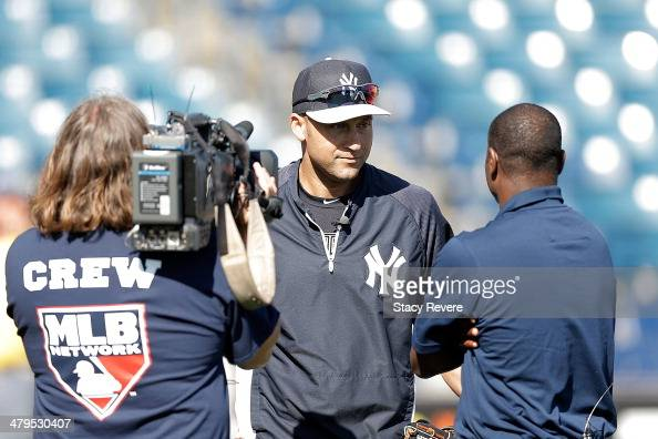 Derek Jeter of the New York Yankees speaks with the media prior to a game against the Boston Red Sox at George M Steinbrenner Field on March 18 2014...