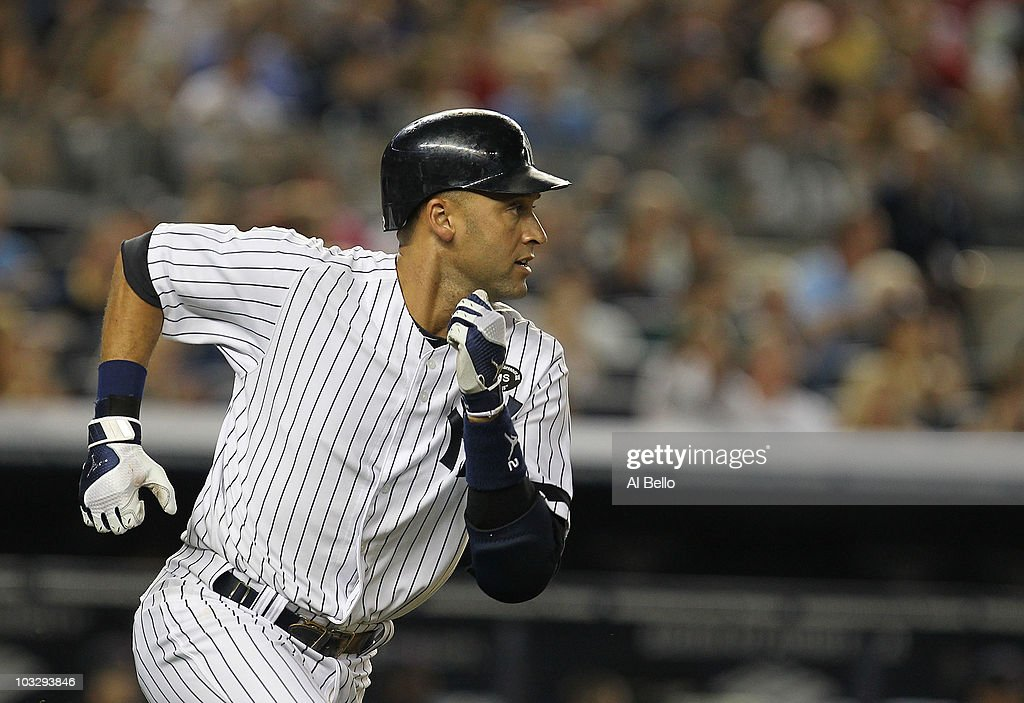 <a gi-track='captionPersonalityLinkClicked' href=/galleries/search?phrase=Derek+Jeter&family=editorial&specificpeople=167125 ng-click='$event.stopPropagation()'>Derek Jeter</a> #2 of the New York Yankees surpasses Babe Ruth in all time hits with 2874 against the Boston Red Sox in the second inning against the Boston Red Sox on August 8, 2010 at Yankee Stadium in the Bronx borough of New York City.