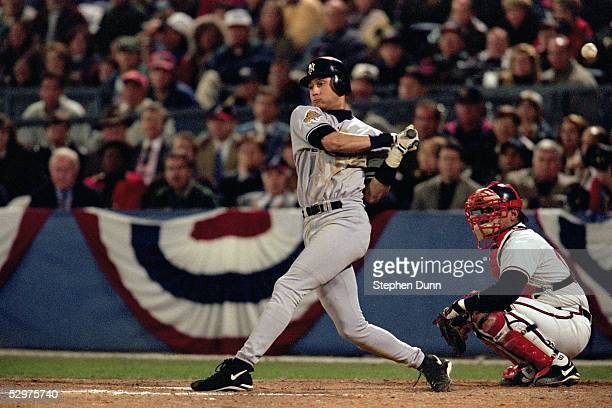 Derek Jeter of the New York Yankees swings at a pitch during Game four of the 1996 World Series against the Atlanta Braves at AtlantaFulton County...